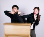 man & woman struggle over mic iStock_000001361410XSmall